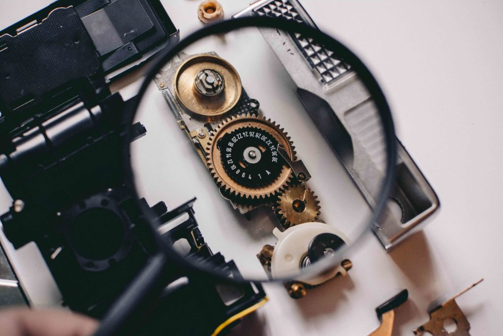 magnifying glass showing camera gears